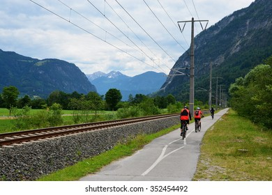 Austrian Alps - cyclists on the cycle path along the river Draw