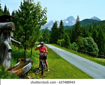 Austrian Alps-cyclist and mountain spring water