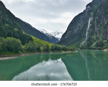 Austrian Alps-outlook of the lake Stillupspeicher and waterfall
