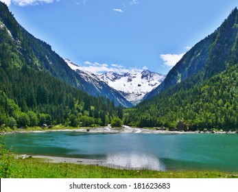 Austrian Alps-outlook on the dam Stillup and snow-capped Alps