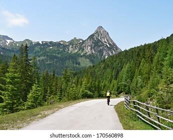 Austrian Alps-unidentified cyclist and peak Riedlingspitze