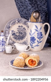 Austrian and czech sweet dessert knedle apricot dumplings against white blue antick vintage dishes. Filled cottage cheese dough.  - Shutterstock ID 1892204956