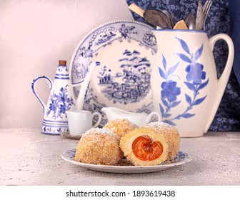 Austrian and czech sweet dessert knedle apricot dumplings against white blue antick vintage dishes. Filled cottage cheese dough. - Shutterstock ID 1893619438
