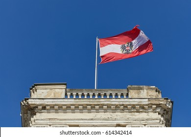 Austrian flag waving against blue sky