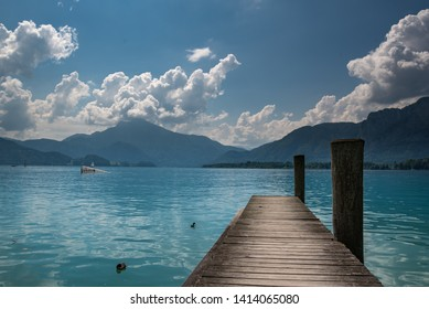 Austrian lake Attersee with pier leading towards the background