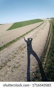 austrian landscape with shadow of a person