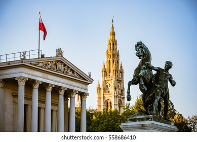 Austrian Parliament and Vienna's Historical City  Hall behind a bronze horse tamer, Vienna, Austria