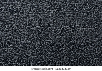 Authentic black leather background close up and detailed