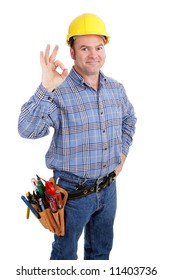 Authentic construction worker giving the A-okay sign for success.  Isolated on white.