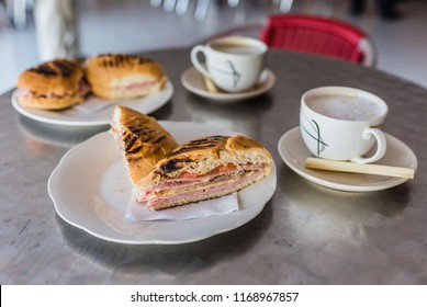 Authentic Cuban Sandwich grilled with layered ham, cheese, tomatoes, and pickles. Accompanied by a demitasse of coffee and steamed milk, and served with a stirring stick of fresh sugar cane.