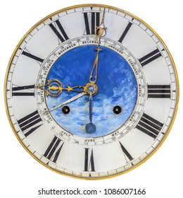 Authentic eighteenth century clock face with painted decoration isolated on a white background