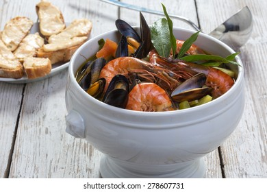 Authentic French Bouillabaisse fish soup with rouille on bread