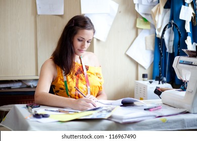 Authentic image of a fashion designer working in her studio