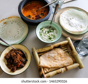 Authentic Indian cuisine / Brunch Meal of Kerala Origin / Fish Biryani, appam, chapati, mutton thali, prawn mango curry, mashed brinjal with yogurt dip sauce