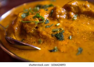 Authentic Indian cuisine Tikka Masala with moody dark lighting