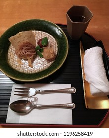 Authentic Japanese Cuisine, with traditional Japanese letters mean Hotel in English shown on the paper napkin, spoon and fork