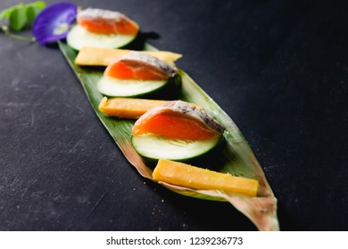 Authentic Japanese fish served on a leaf.