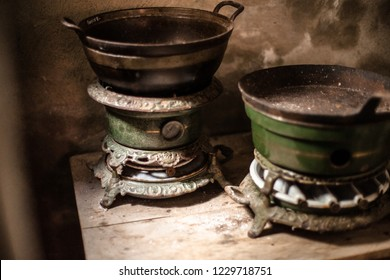 . The authentic kitchen utensils. Vintage kettle and old kerosene stove.