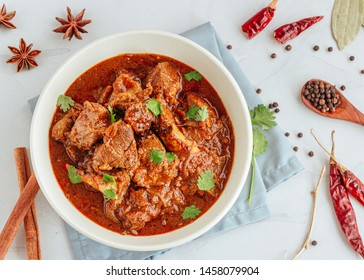 Authentic Lamb Vindaloo Traditional Fiery Red Goan Curry of Lamb.