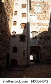 Authentic medieval courtyard and stone walls of the historic medieval castle Abo fortress in the city of Turku in Finland on a sunny summer day.