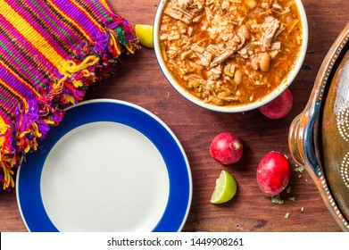 Authentic Mexican birria stew, a traditional food from the state of Jalisco,served with tortillas, radish and lime. Concept for Mexican restaurants, food blogs, menus, etc.