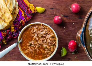 Authentic Mexican birria stew, a traditional food from the state of Jalisco. Usually made with goat or beef. Served with tortillas, radish and lime. Concept for Mexican restaurants, food blogs, menus