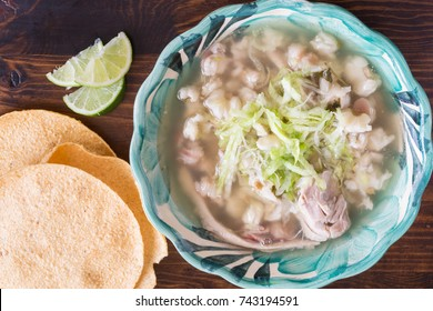 Authentic Mexican Pozole soup with lettuce and lime