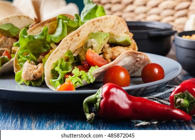 Authentic mexican tacos with chicken and salsa with avocado, tomatoes and chilies. Mexican cuisine.