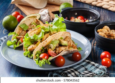 Authentic mexican tacos with chicken and salsa with avocado, tomatoes and chillies. Mexican cuisine.