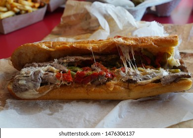 Authentic Philly Cheese Steak Sandwich. Philadelphia, Pennsylvania tradition. Large hoagie steak sandwich with melted cheese and peppers. Yummy!