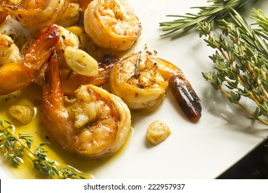 Authentic Portuguese Garlic Shrimp garnished with rosemary and thyme