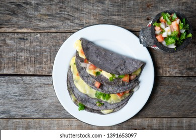 Authentic quesadillas with blue corn tortillas and mexican sauce