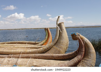 Authentic reed boats from titicaca lake in peru and bolivia floating over the water, traditional bonding concept with reed