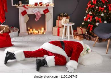 Authentic Santa Claus lying on floor indoors