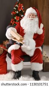 Authentic Santa Claus reading wish list indoors