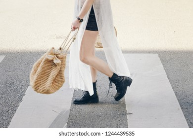authentic street style. attractive woman wearing a fashionable outfit crossing the street. fashion outfit perfect for summer city days.