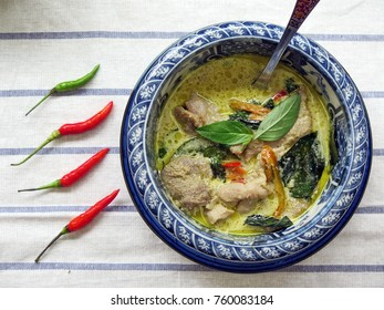 Authentic Thai Food Curry Pork with Coconut milk on Stripe white cloth background and chili