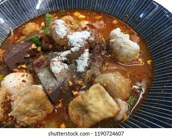 Authentic Thai-style noodle soup with fishballs, crispy wonton skin, and special homemade red sauce., Yen-Ta-Four