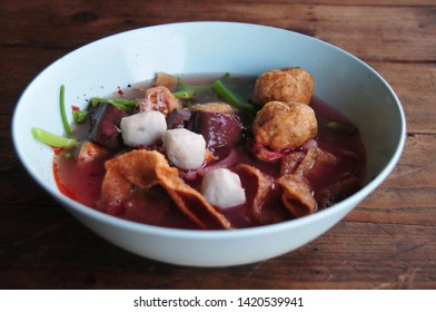 Authentic Thai-style noodle soup with fishballs, crispy wonton skin, and special homemade red sauce
