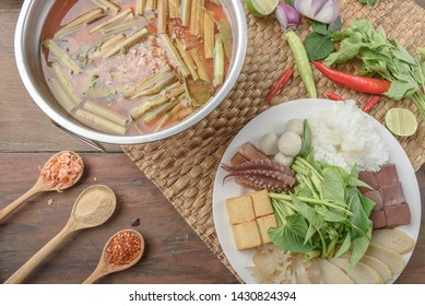 Authentic Thai-style noodle soup with fishballs, crispy wonton skin, and special homemade red sauce served with hot pot