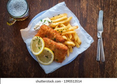 Authentic traditional British cuisine fish and chips served with an ice cold beer