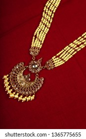 Authentic Traditional Indian Jewelery Necklace On Dark Background. Wear in Neck in Wedding, Festivals And Other Occasion. Very Useful Image For Website, Printing & Mobile Application