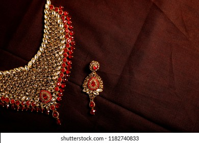 Authentic Traditional Indian Jewellery  Necklace And Earring On Dark Background. Wear in Neck in Wedding, Festivals  And Other Occasion. Very Useful Image For Website, Printing & Mobile Application.