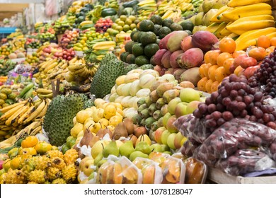 Authentic tropical fruit market in Quito, Ecuador, with assortment of many fruit types.