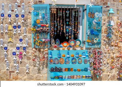 Authentic Turkish souvenir shop with plates and variety of souvenirs stating Side. Side is a city, major coastal tourist attraction in Antalya province, Turkey.