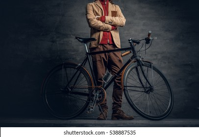 An authentic vintage single speed hipster's bicycle over grey wall background.