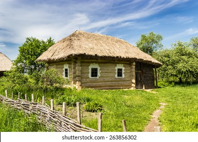 Authentic wooden farmhouse with thatched roof from historical area of Polesie, 19th century. National Museum of Ukrainian Architecture and Culture, Kiev, Ukraine.