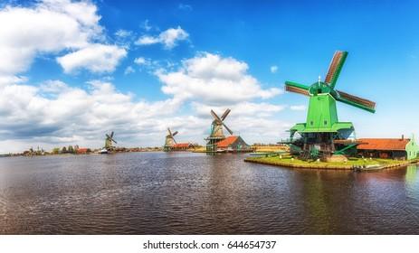 Authentic Zaandam mills on the water channel in Zaanstad, The Netherlands