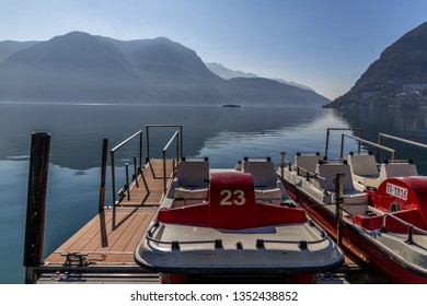 Authethic paddleboat in Lake Lugano in Switzerland with the mountains and the lake in the background
