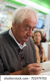 Author Cees Nooteboom signing a book at the Frankfurt Bookfair / Buchmesse Frankfurt 2016 in Frankfurt am Main, Germany